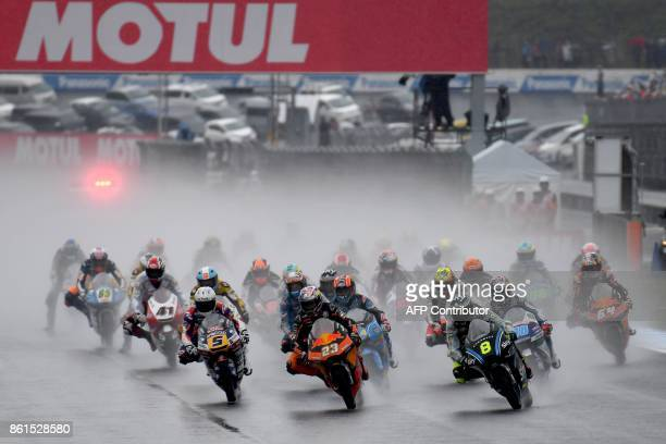 KTM rider Nicolo Bulega of Italy leads the pack entering the first turn after the start of the Moto3 class at the MotoGP Japanese Grand Prix at Twin...