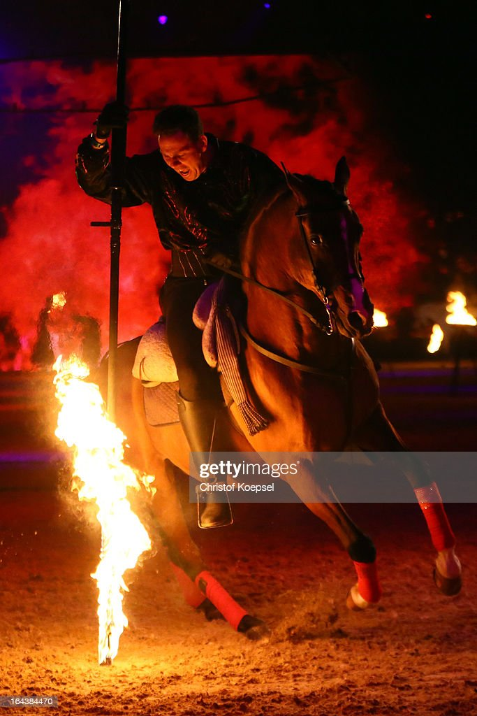 A rider of the Excalibur show in action during the walpurgisnight show during the Equitana Hop Top Show at Grugahalle on March 23, 2013 in Essen, Germany.
