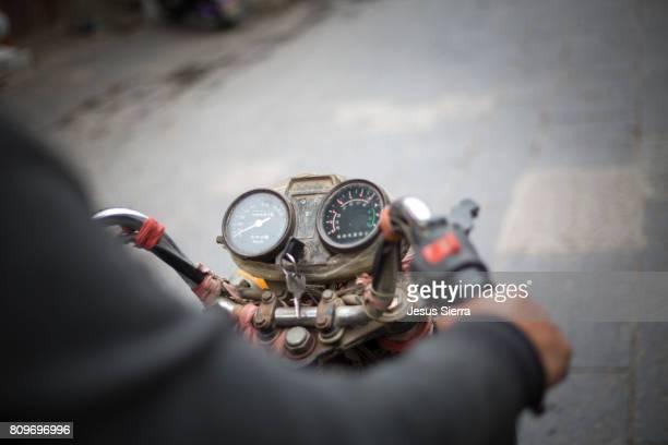Rider on motorbike, Jianshui. China.