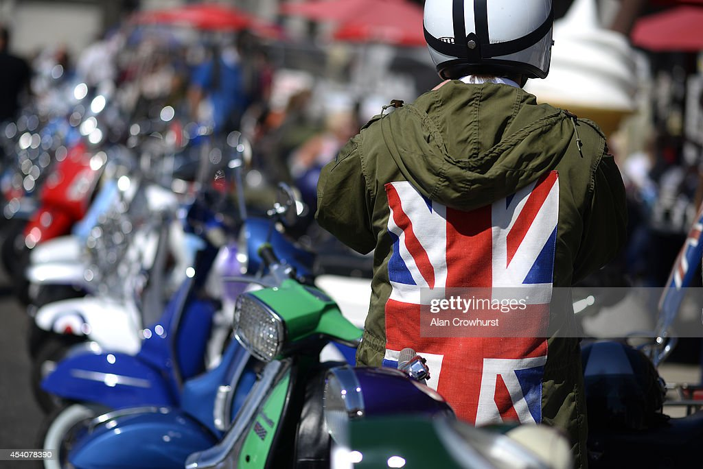 A rider parks his scooter during the Brighton Mod weekender on August 24, 2014 in Brighton, England. This August Bank holiday will see many Mods and their scooters return to their spiritual home of Brighton for the Mod Weekender event.