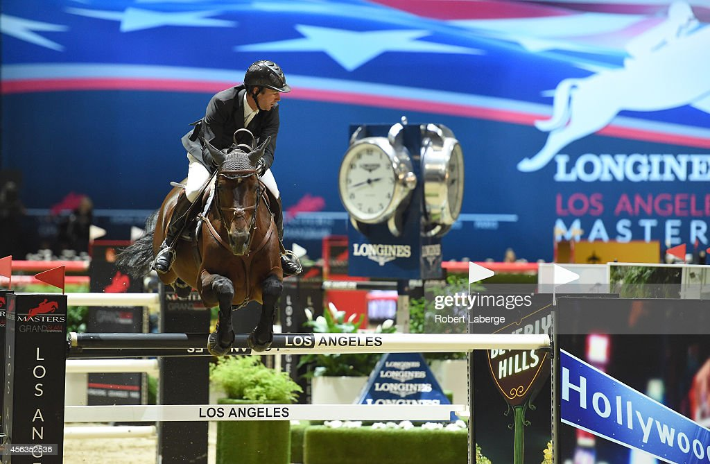 Rider <a gi-track='captionPersonalityLinkClicked' href=/galleries/search?phrase=Patrice+Delaveau&family=editorial&specificpeople=2328789 ng-click='$event.stopPropagation()'>Patrice Delaveau</a> of France rides Carinjo during the Longines Grand Prix class as part of the Longines Los Angeles Masters at Los Angeles Convention Center on September 28, 2014 in Los Angeles, California.