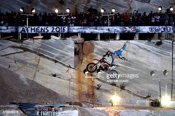 A rider performs a jump during the Athens 2015 Red Bull XFighters international freestyle motocross at the Ahens' Dionyssos Quarry on June 13 2015...
