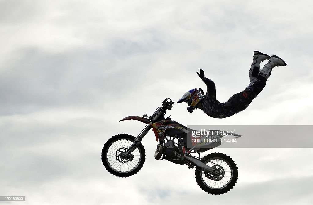 A rider performs during the Red Bull X-fighters Jams freestyle show at the Simon Bolivar park as part of the Summer Festival in Bogota, Colombia, on August 11, 2012. AFP PHOTO/Guillermo Legaria