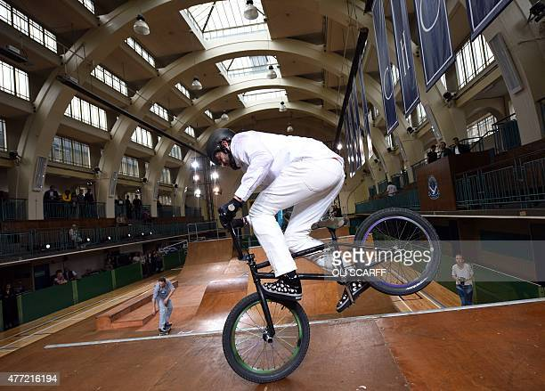 A BMX rider performs in Seymour Leisure Centre at a presentation for designer British designer Jimmy Choo on the fourth day of the Spring/Summer 2016...