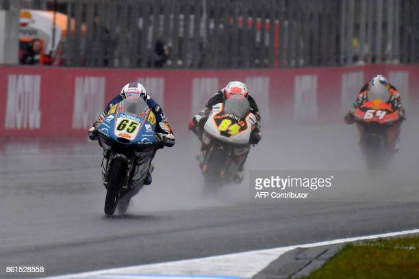 KTM rider Philipp Oettl of Germany leads Peugeot rider Jakub Kornfeil of the Czech Republic and KTM rider Bo Bendsneyder of the Netherlands during...