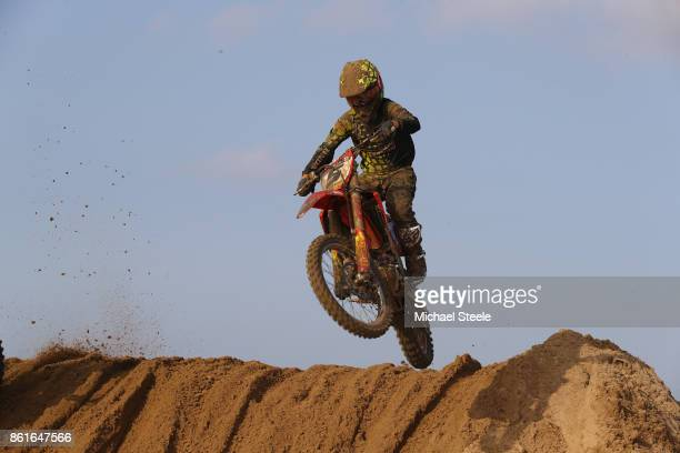 A rider reaches the top of a sand dune during the Adult Solo race during day two of the HydroGarden Weston Beach Race on October 15 2017 in...