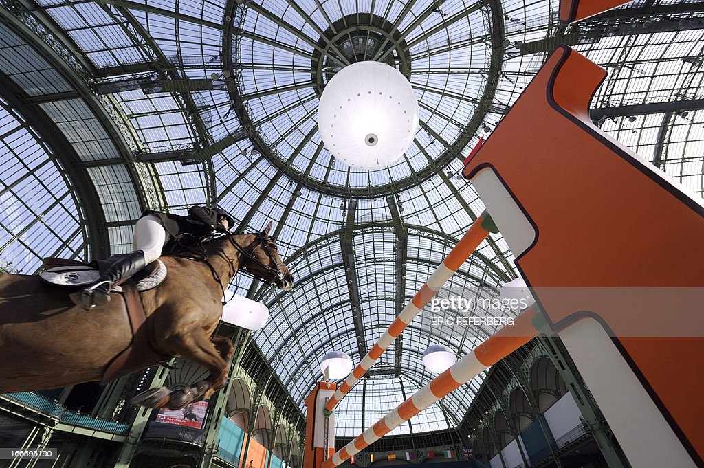 US rider Reed Kessler on Cylana clears an obstacle on April 14, 2013 to win the second place of the jumping event of the Grand Prix Hermes of Paris at the Grand Palais in Paris.