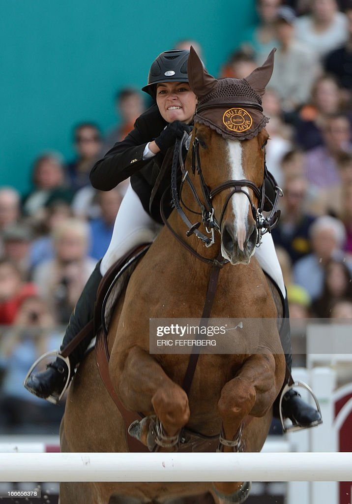 US rider Reed Kessler on Cylana clears an obstacle on April 14, 2013 to win the second place of the Grand Prix Hermes of Paris jumping event at the Grand Palais in Paris.