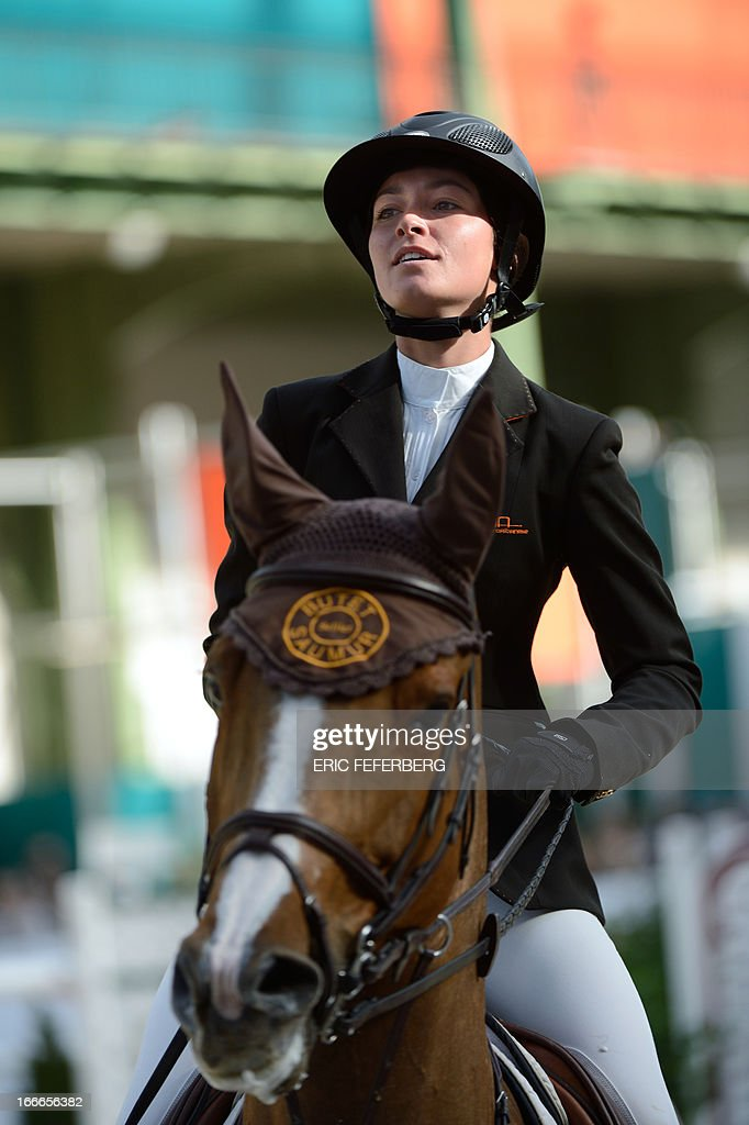 US rider Reed Kessler on Cylana smiles on April 14, 2013 after winning the second place of the Grand Prix Hermes of Paris jumping event at the Grand Palais in Paris. AFP PHOTO / ERIC FEFERBERG
