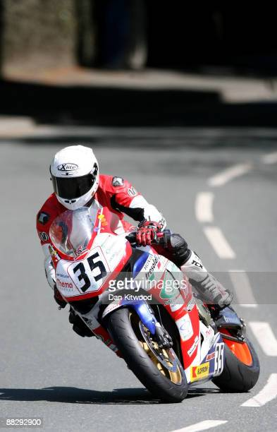 A rider takes the corner at Quarterbridge during the superbike TT race in Douglas on June 8 Isle Of Man United Kingdom The annual TT race is one of...