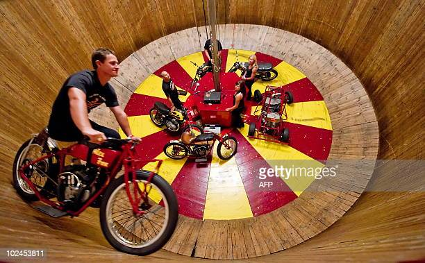 A rider takes to the 'Wall of Death' within the Block 9 area at the Glastonbury festival near Pilton Somerset on June 27 2010 Celebrating its 40th...