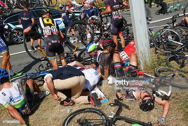 Riders and bikes are strewn across the roadside following a crash near Brabant Wallon during stage three of the 2015 Tour de France a 1595 km stage...