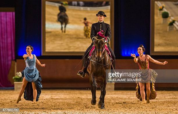 Riders and dancers perform at the French national equestrian school 'Le Cadre noir de Saumur' during the new show 'Danse avec le Cadre Noir' in...