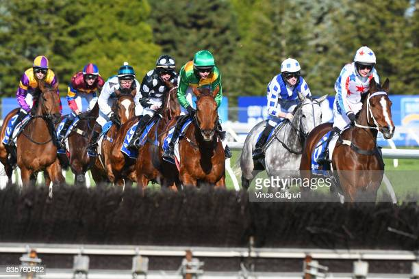 Riders approach the first hurdle in Race 4 JJ Houlahan Hurdle during The Grand National Steeple Day on August 20 2017 in Ballarat Australia