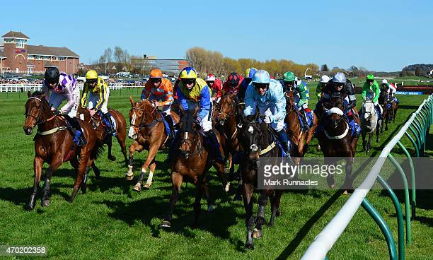 Riders bunched together on the second lap of the Coral Scottish Grand National Handicap Chase on the second day of the Scottish Grand National...
