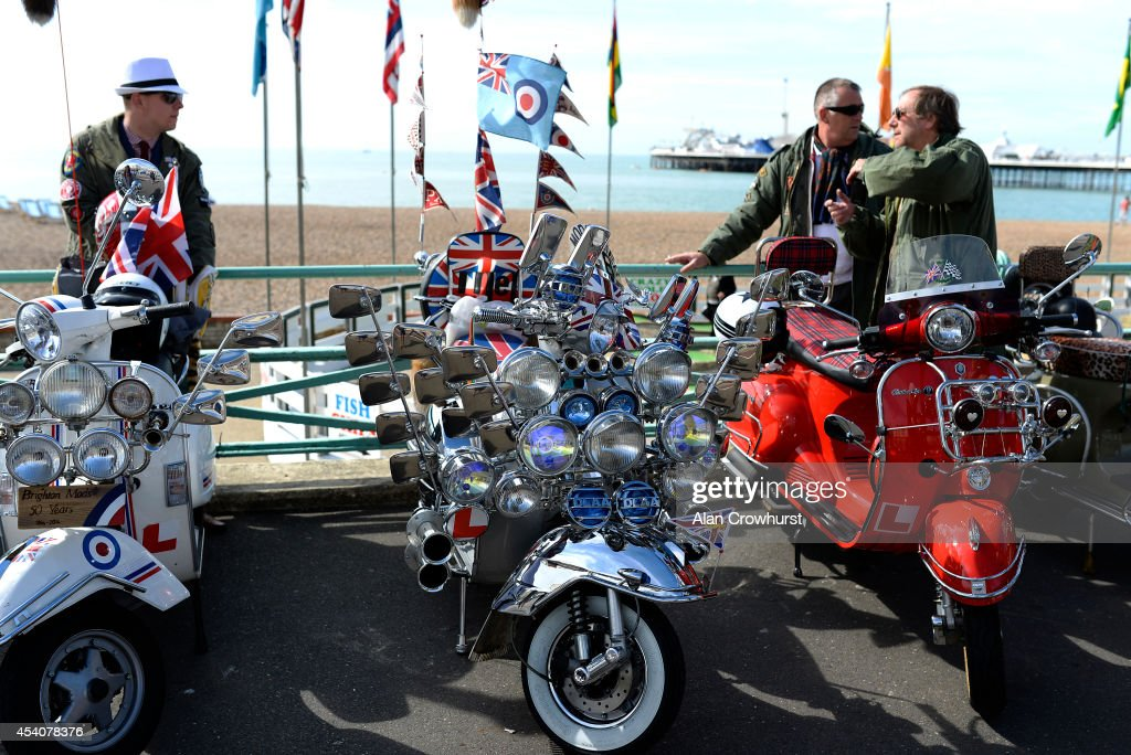 Riders chat about their scooters during the Brighton Mod weekender on August 24, 2014 in Brighton, England. This August Bank holiday will see many Mods and their scooters return to their spiritual home of Brighton for the Mod Weekender event.