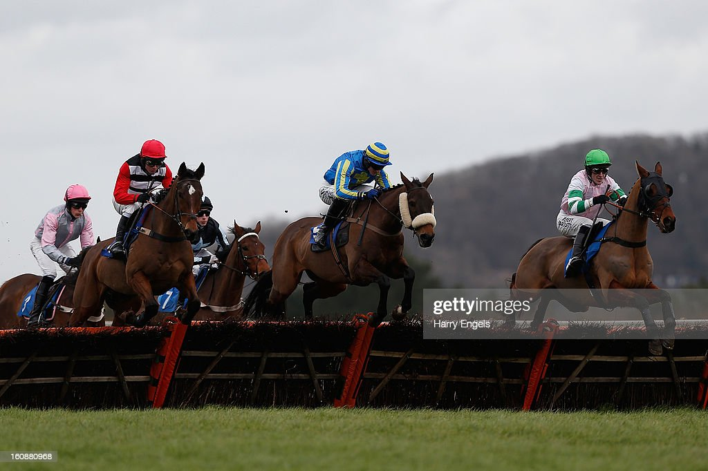 Riders clear a hurdle during the Rural Living Show 23rd Match Claiming Hurdle Race at Taunton Racecourse on February 7, 2013 in Taunton, England.