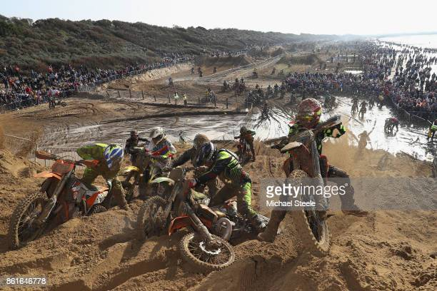 Riders climb a huge sand dune during the Adult Solo race during day two of the HydroGarden Weston Beach Race on October 15 2017 in WestonSuperMare...