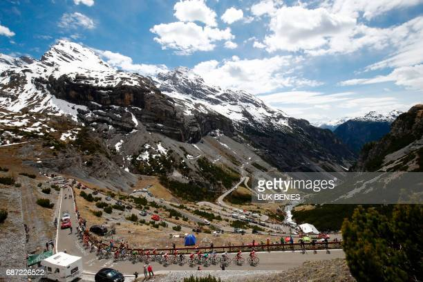Riders climb the Stelvio during the 16th stage of the 100th Giro d'Italia Tour of Italy cycling race from Rovetta to Bormio on May 23 2017 / AFP...