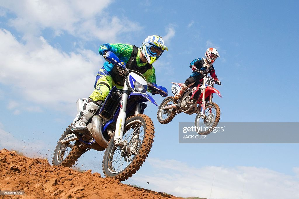 Riders come off a jump during the inauguration of the MX Wingate Motocross track near the Israeli city of Netanya on February 11, 2016. / AFP / JACK GUEZ