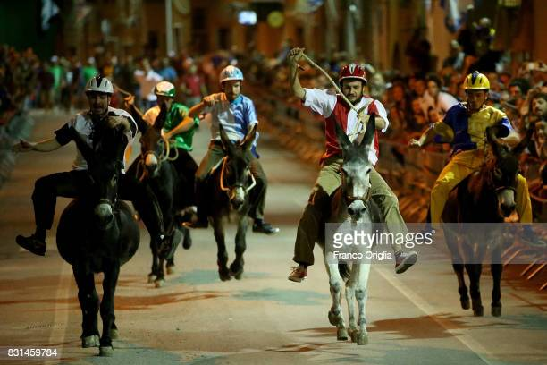 Riders compete during the 87th Palio dei Ciuchi on August 14 2017 in Roccatederighi Grosseto Italy Palio dei Ciuchi' represents with the Medioevo nel...