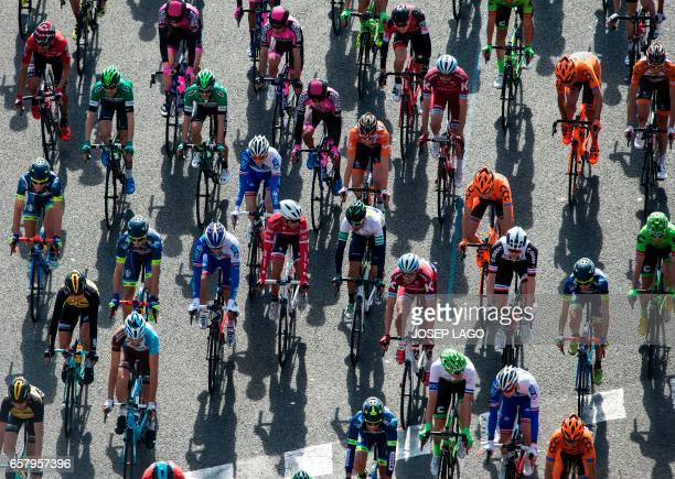 TOPSHOT Riders compete during the 97th Volta Catalunya 2017 a 1387km from Barcelona to Barcelona in Barcelona on March 26 2017 / AFP PHOTO / Josep...