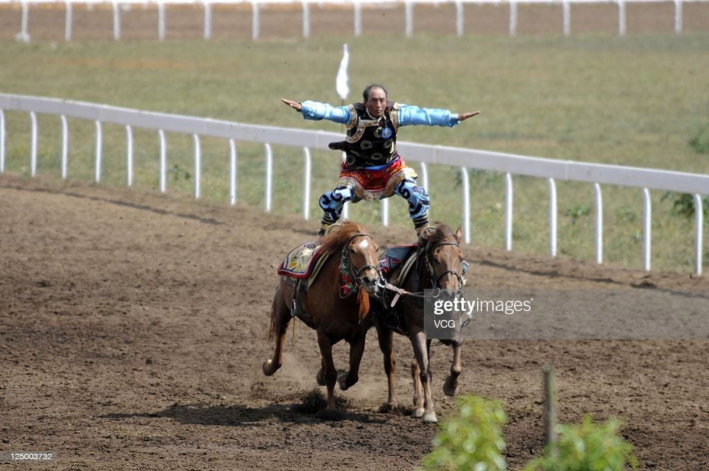 Riders compete during the 9th National Traditional Games of Ethnic Minorities of the People's Republic of China on September 14, 2011 in Guiyang, China.