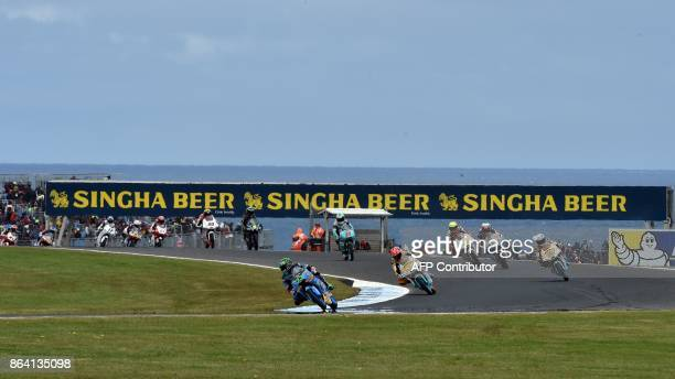 Riders compete during the qualifying session of the Moto3class at the Australian MotoGP Grand Prix at Phillip Island on October 21 2017 / AFP PHOTO /...