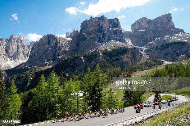 Riders compete in the Dolomites mountains during the 18th stage of the 100th Giro d'Italia Tour of Italy cycling race from Moena to Ortisei on May 25...