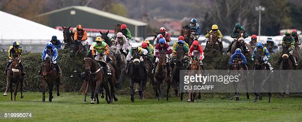 Riders compete in The Grand National Steeple Chase on the final day of the Grand National Festival horse race meeting at Aintree Racecourse in...