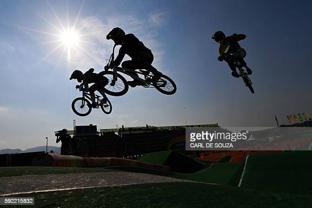 TOPSHOT Riders compete in the Men's BMX Final event at the Rio 2016 Olympic Games at the X Park Stadium in Rio de Janeiro on August 19 2016 / AFP /...
