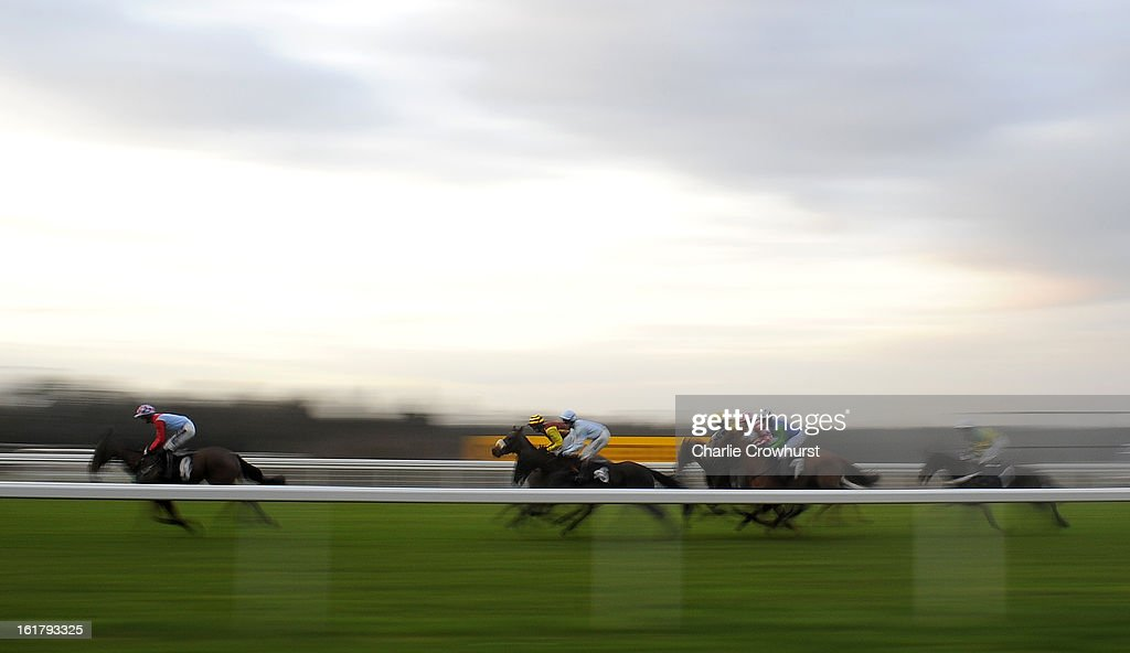 Riders complete the first lap of The IronSpine Charity Challenge Novices' Hurdle Race at Ascot racecourse on February 16, 2013 in Ascot, England.