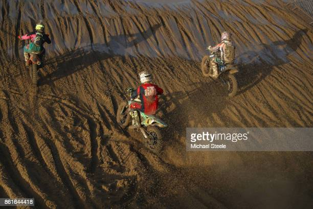 Riders descend a sand dune during the Adult Solo Race during day two of the HydroGarden Weston Beach Race on October 15 2017 in WestonSuperMare...