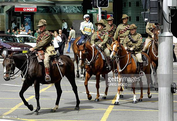Riders dressed as the famed 19141918 Light Horse soldiers parade down a Sydney street on their way to the Anzac war memorial for the handing over...