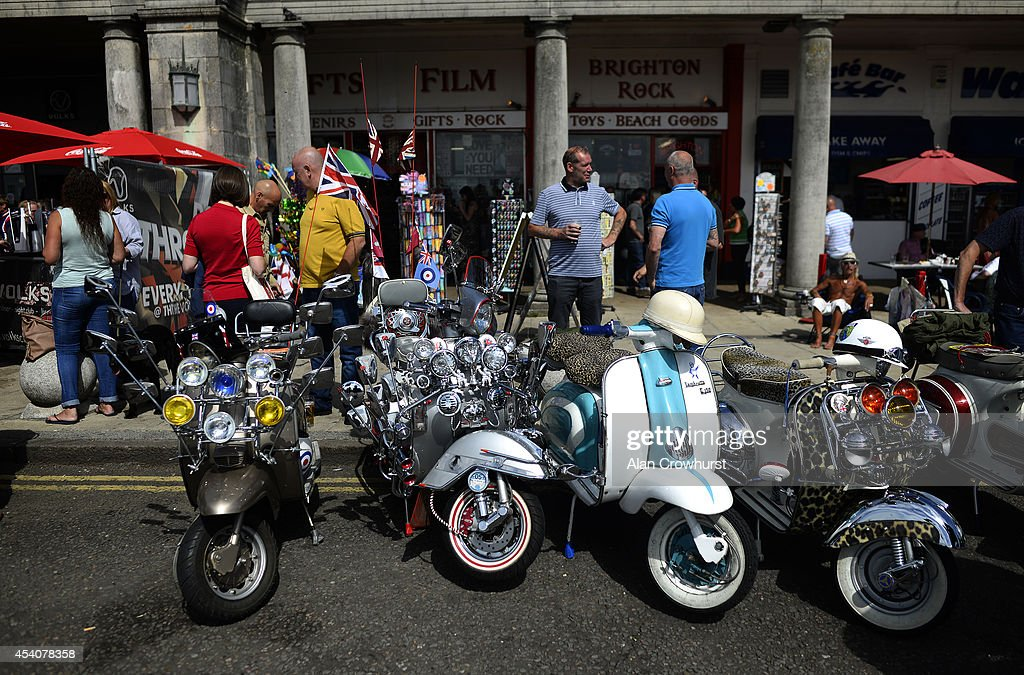Riders enjoy a drink during the Brighton Mod weekender on August 24, 2014 in Brighton, England. This August Bank holiday will see many Mods and their scooters return to their spiritual home of Brighton for the Mod Weekender event.