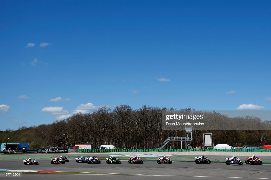 Riders enter the first corner during the World Superbikes Race 2 at TT Circuit Assen on April 28, 2013 in Assen, Netherlands.