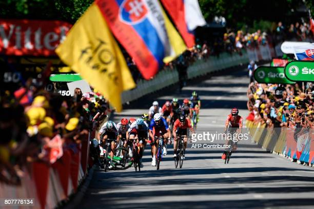 Riders fall near the finish line at the end of the 2075 km fourth stage of the 104th edition of the Tour de France cycling race on July 4 2017...