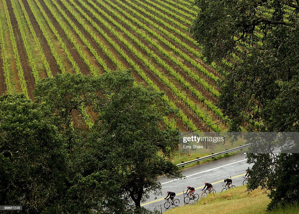 Riders for Team Radio Shack lead teammate Lance Armstrong of the USA (four rider) past a vinyard during stage two of the Tour of California on May 17, 2010 in Napa, California.