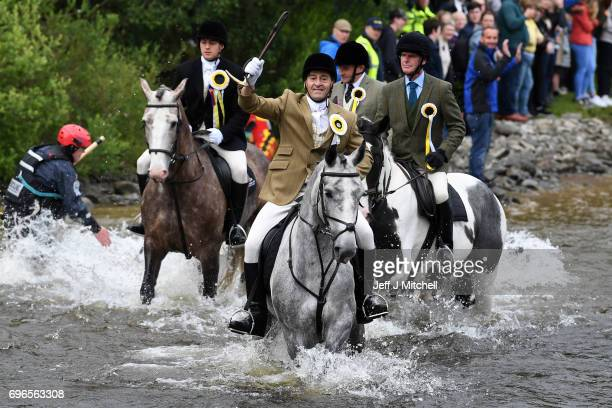 Riders ford the river Ettrickas they take part in the town's Common Riding one of the oldest Borders festivals June 16 2017 in Selkirk Scotland The...