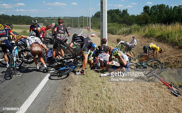 Riders get to their feet and assess damage to bikes following a crash near Brabant Wallon during stage three of the 2015 Tour de France a 1595 km...