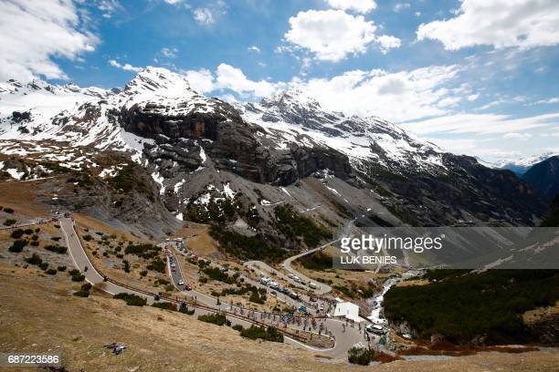 Riders go down the Stelvio during the 16th stage of the 100th Giro d'Italia Tour of Italy cycling race from Rovetta to Bormio on May 23 2017 / AFP...