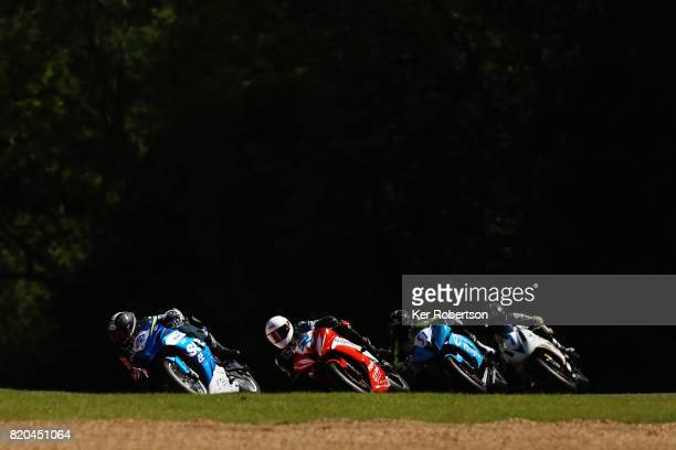 Riders go through Dingle Dell during practice for the Dickies British Supersport Championship at Brands Hatch on July 21 2017 in Longfield England