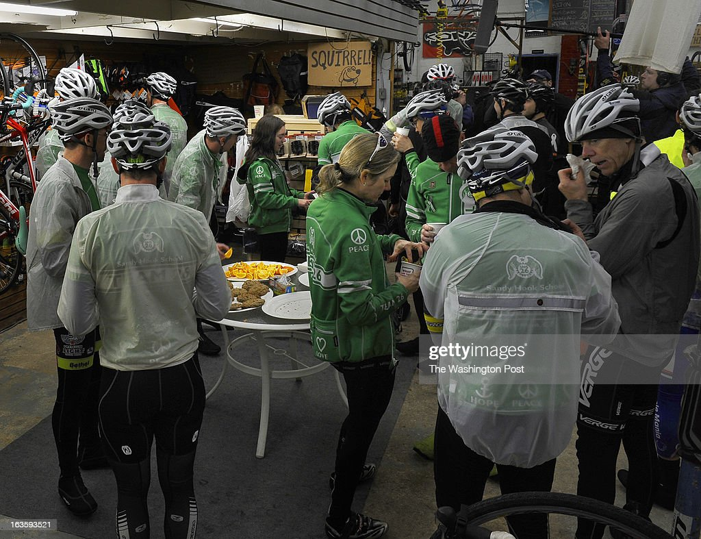 Riders got some food and hot coffee at Proteus Cycles (a bike store) in College Park where they took a break. A group of 26 riders biked from Newtown, CT to Washington, D.C. for a rally in support of gun control legislation. At a stop in College Park, MD they were joined by 3 riders from a team honoring the Virginia Tech shooting victims. Photo by Michael S. Williamson/The Washington Post via Getty Images