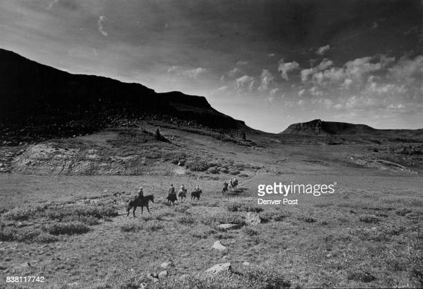 Riders head across WideOpen Spaces in headwater area of the south fork of the white river in flat tops wilderness The wilderness area resting at...