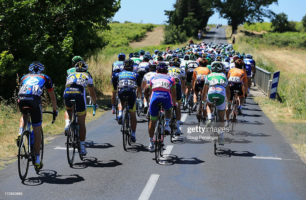 Riders head towards a small bridge where a crash occurs during stage seven of the 2013 Tour de France, a 205.5KM road stage from Montpellier to Albi, on July 5, 2013 in Montpellier, France.