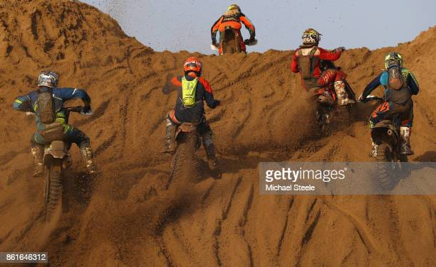 Riders head up a sand dune during the Adult solo race during day two of the HydroGarden Weston Beach Race on October 15 2017 in WestonSuperMare...