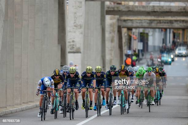 Riders in the first pack cross the Ebro river of the sixth stage of the 97th Volta Catalunya 2017 a 1897km from Tortosa to Reus in Mora D'Ebre on...