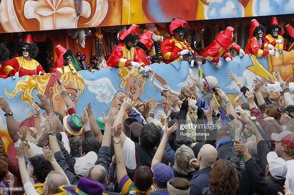 Riders in the Krewe of Zulu parade toss beads to the crowd below on Canal Street in New Orleans on Mardi Gras Day Fat Tuesday the traditional...