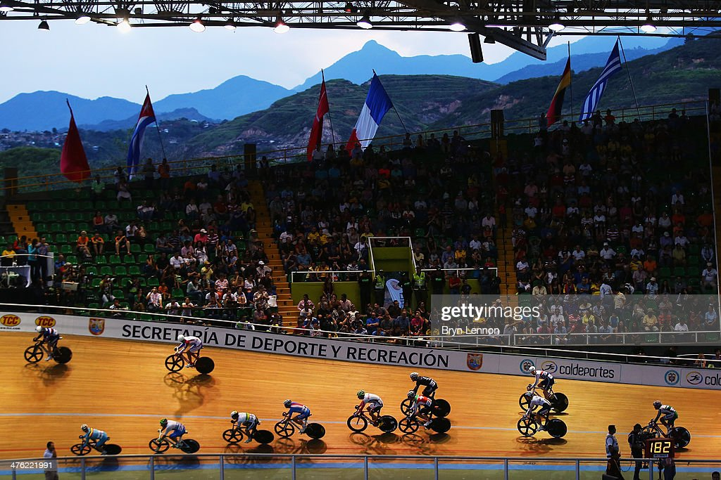 Riders in the Madison lap the field during day five of the 2014 UCI Track Cycling World Championships at the Velodromo Alcides Nieto Patino on March...