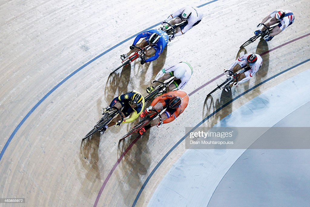 Riders including Jacob Schmid of Australia, Joachim Eilers of Germany, Jason Kenny of Great Britain, Matthijs Buchli of the Netherlands and Kazunari Watanabe of Japan compete in the Mens Keirin first round race during day 2 of the UCI Track Cycling World Championships held at National Velodrome on February 19, 2015 in Paris, France.